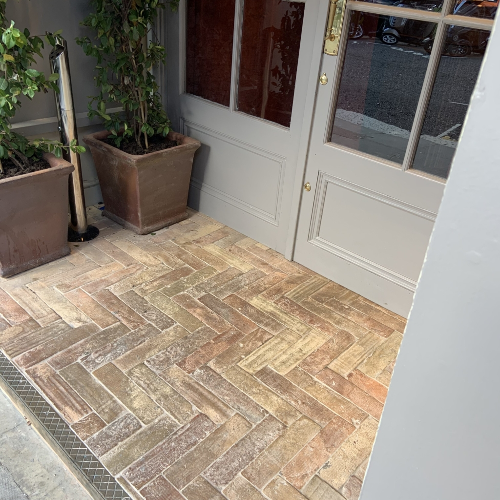 herringbone pattern tile on a porch