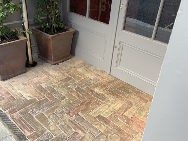herringbone pattern tile on a porch