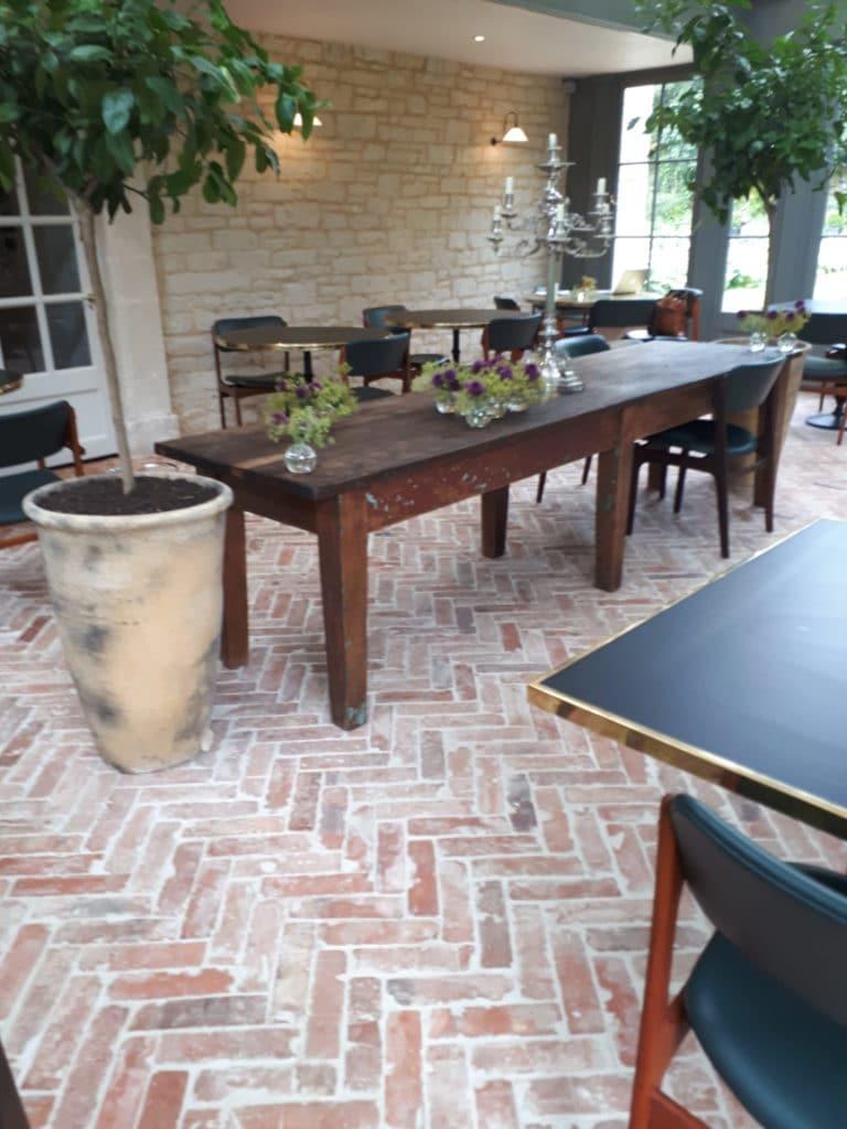 Reclaimed Brick floor tile in a herringbone and lime wash