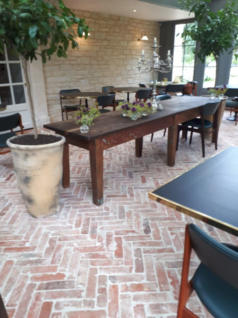 conservatory with a herringbone brick tile