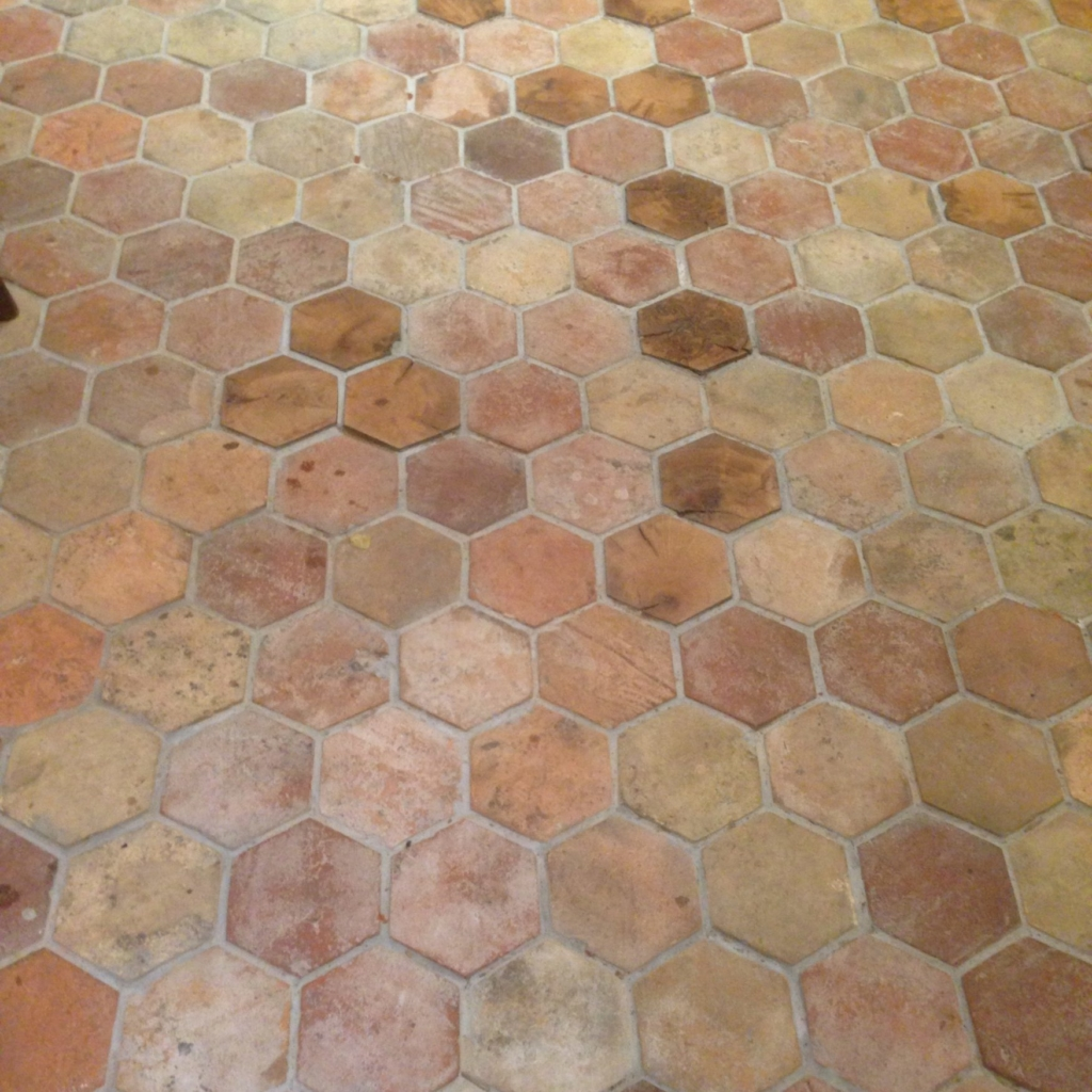 hexagonal reclaimed warm terracotta tiles