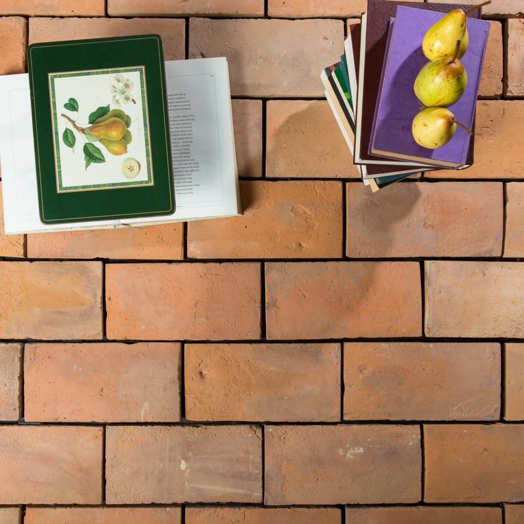 Large warm terracotta floor tile