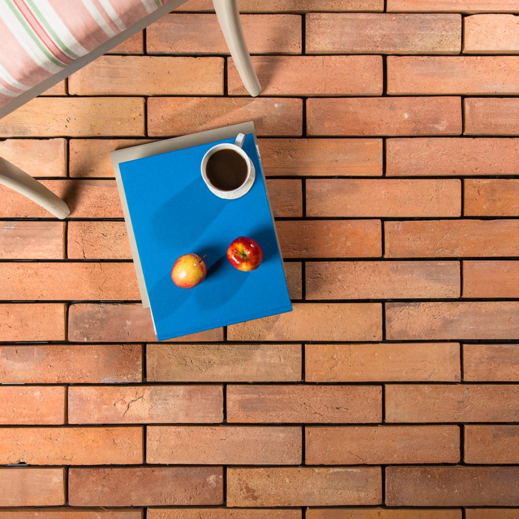 Thin warm terracotta tile