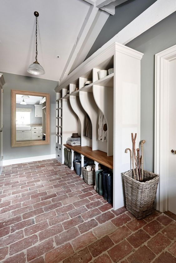 Cloak room with reclaimed brick floor